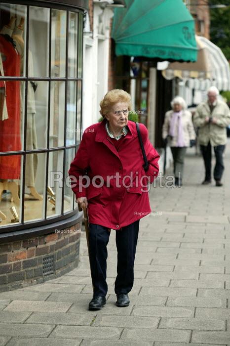 Elderly lady with a walking stick in the street. Stratford on Avon - John Harris - 2003-05-20