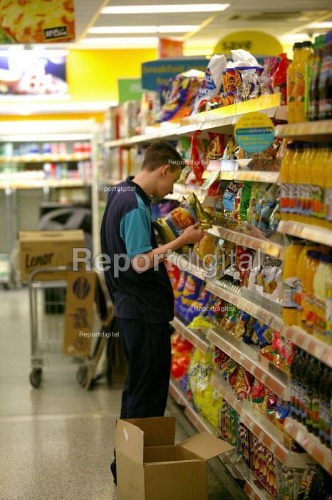 Young worker filling shelves Somerfield Supermarket. - John Harris - 2003-05-20