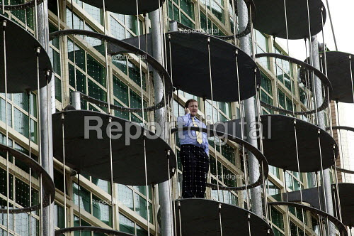Businessman making a mobile phone call from office balcony. Birmingham - John Harris - 2003-05-22