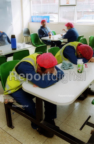 Exhausted workers catch a few minutes sleep during their break, canteen. British Bakeries, Birmingham - John Harris - 2002-08-27