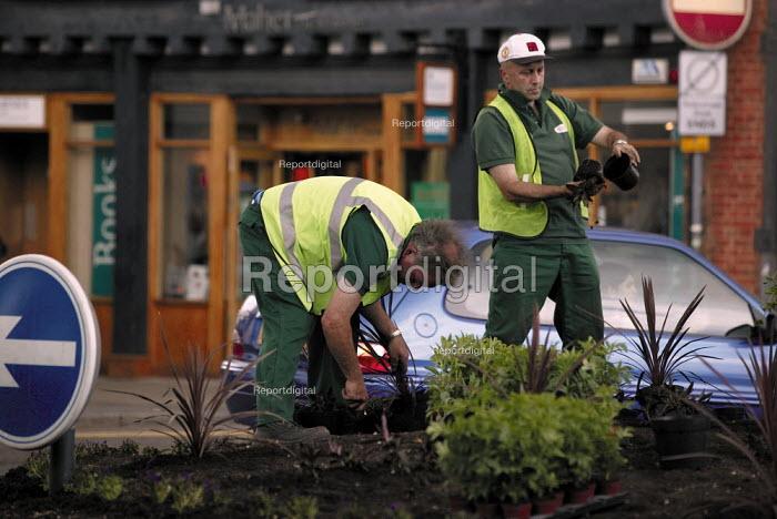 Gardeners planting in a traffic roundabout. - John Harris - 2003-06-10