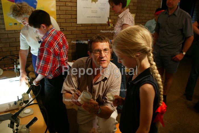 Scientist talking to children visiting Defra, The Royal Show Stoneleigh - John Harris - 2003-06-29