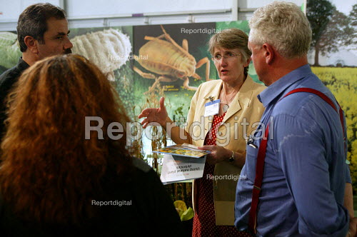 Scientist talking to visitors at Defra, The Royal Show Stoneleigh - John Harris - 2003-06-29