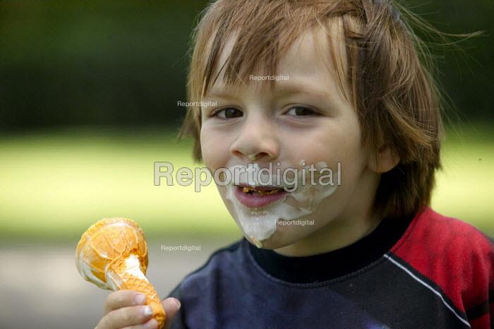 Little boy enjoying an icecream in the park. - John Harris - 2003-07-13