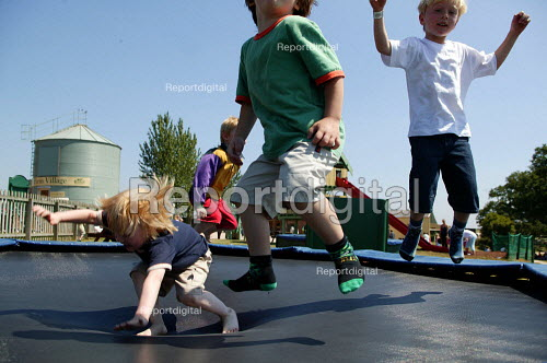 Boys bouncing on a trampoline at a country park. Warwickshire - John Harris - 2003-07-15