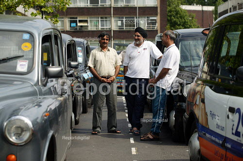 Taxi Drivers chatting at a Taxi rank whilst waiting for fares, Coventry Railway Station. - John Harris - 2003-08-05
