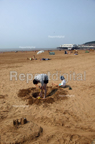 Farther digging a sand castle on the beach Weston Super Mare in the hottest temperatures. - John Harris - 2003-08-04