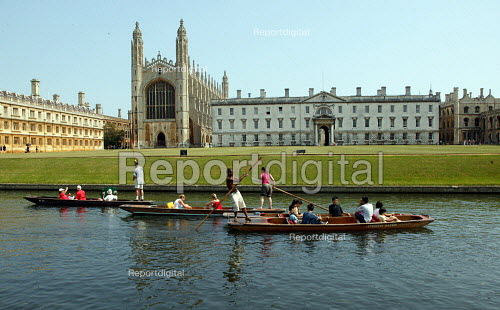 Students and tourists punting along The Backs by King's College Chapel and University, Cambridge. Punt chauffeurs pushing them along - John Harris - 2003-08-10