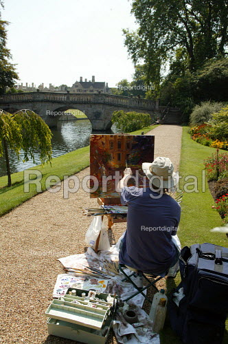 A painter painting students and tourists punting along The Backs, by Clare Bridge, Clare College, Cambridge. - John Harris - 2003-08-10