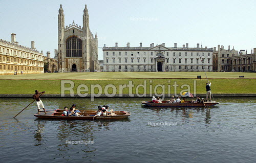Students and tourists punting along The Backs, by King's College Chapel and University, Cambridge. Punt chauffeurs punt them along. - John Harris - 2003-08-10