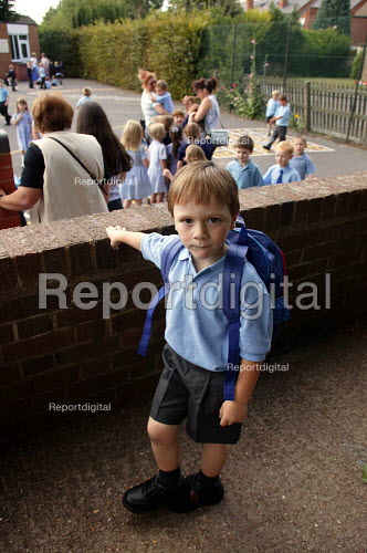Schoolboy about to enter the playground on his first day at school. - John Harris - 2003-09-02