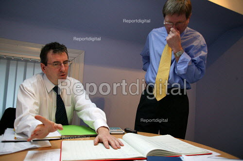 Accountant and client in discussion at a meeting. - John Harris - 2003-11-17
