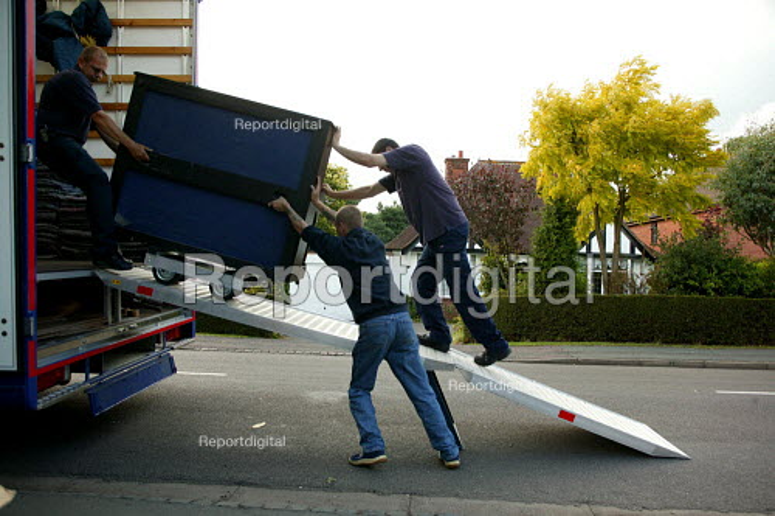 Removal men unloading a pantechnicon. - John Harris - 2004-07-02