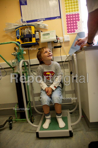 Patient aged 5 being weighed on scales prior to being examined by heart specialist to diagnose a heart murmur. Birmingham Children's Hospital. - John Harris - 2004-07-08