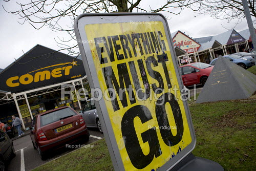Everything must go bright yellow sign outside Comet, the electrical retailer which has gone into administration, Coventry - John Harris - 2012-11-17