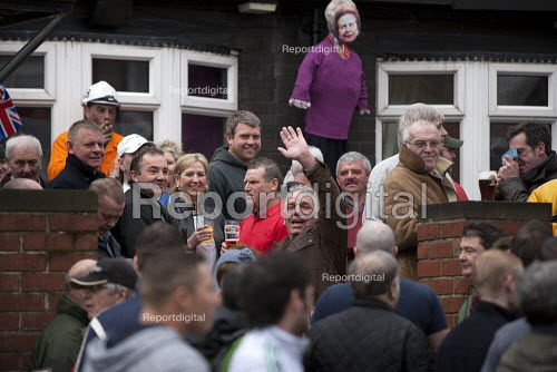 Miners and their families enjoying a drink with an effigy of Margaret Thatcher. Protest on the day of the funeral of Margaret Thatcher, Goldthorpe - a former pit village, South Yorkshire. - John Harris - 2013-04-17