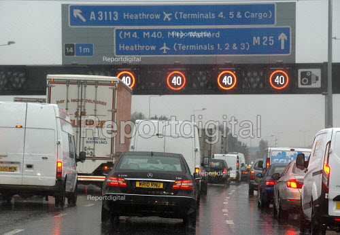 Traffic jam on M25 motorway in rain London - John Harris - 2015-09-15