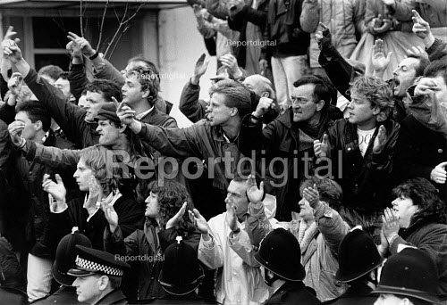 Dover NUS and P&O dispute. Seafarers and their families show their anger at scab crew being bused into the port in an attempt at strike breaking. The P&O ferry company sacked the workers in an attempt to derecognise the National Union of Seamen - John Harris - 1988-04-26