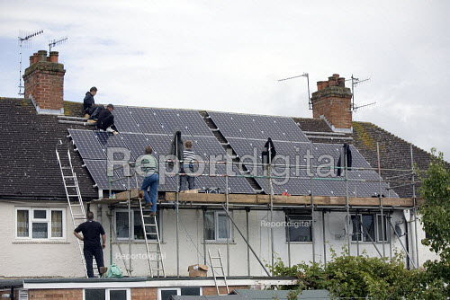 Installing Solar panels on the roof of 2 terraced houses rented for multiple occupancy, Stratford upon Avon, Warwickshire. - John Harris - 2011-07-08