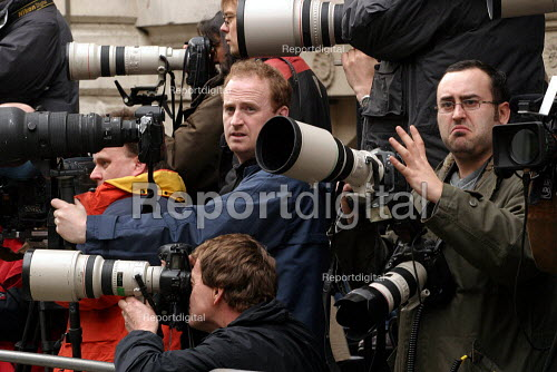 Press photographers wait for the Chancellor Gordon Brown MP to leave number 11 Downing Street to make his budget speech. - Jess Hurd - 2004-03-17