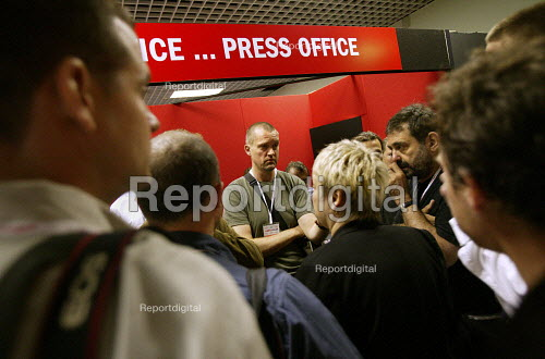Photographers argue with the Labour Party Press Office staff about access for all photographers on conference floor for Tony Blairs speech. Access was granted after a walkout by all photographers during Charles Clarkes address to conference. Labour Party Conference. Brighton. - Jess Hurd - 2005-09-27