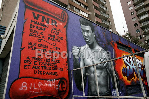 Muhammad Ali mural on an estate in Aulnay Sous Bois. The estate has seen sustained rioting after two youths were killed in a police chase. Paris, France. - Jess Hurd - 2005-11-11