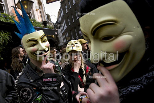 Punks join Space Hijackers celebrating a traditional May Day, Mayfair, London. The masks are from the film V For Vendetta about a future totalitarian Britain opposed by a masked man known only as V. - Jess Hurd - 2008-05-01