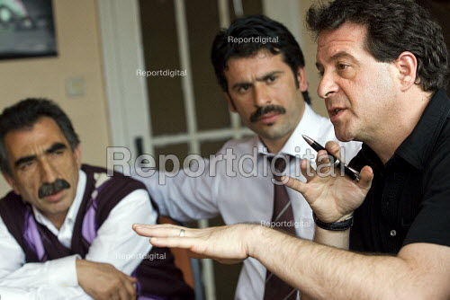 Ex Coca Cola workers being interviewed by Mark Thomas for his book Belching Out the Devil. Istanbul, Turkey. - Jess Hurd - 2008-03-12