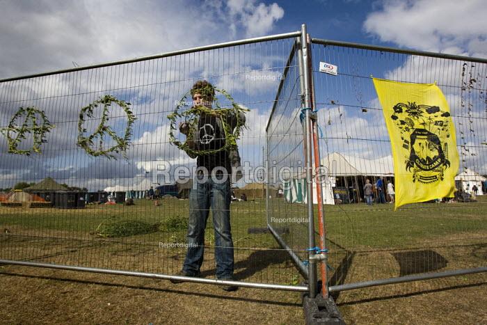 Peace symbols on the fence. Climate Camp on Blackheath. South East London. - Jess Hurd - 2009-08-28
