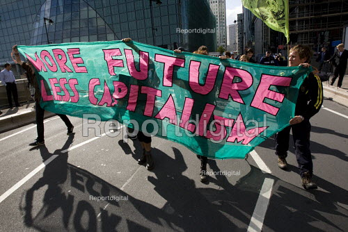 More future less capitalism banner. Climate Camp action outside Barclays Bank offices at Canary Wharf. Investers in EON. London. - Jess Hurd - 2009-08-28