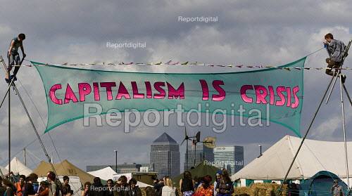 Capitalism is Crisis banner with Canary Wharf. Climate Camp on Blackheath. South East London. - Jess Hurd - 2009-08-28