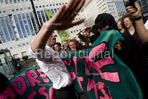 Canary Wharf worker, claiming to be a banker takes the megaphone. Climate Camp action outside Barclays Bank offices at Canary Wharf. Investers in EON. London. - Jess Hurd - 2009-08-28