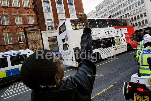 Young man gives the English Defence League the finger as they are taken by police in a bus preventing them from marching in Birmingham - Jess Hurd - 2009-09-05