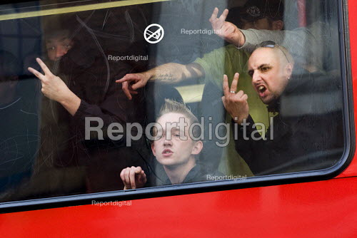 English Defence League making rude gestures and V signs as they are contained on buses to prevent them marching in Birmingham against Islamic Extremism. Chris Renton of the BNP on the right - Jess Hurd - 2009-09-05