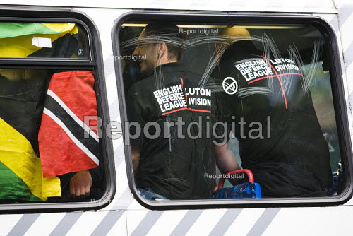 EDL supporters are escorted by the police on a bus out of Birmingham. English Defence League march in Birmingham - Jess Hurd - 2009-09-05
