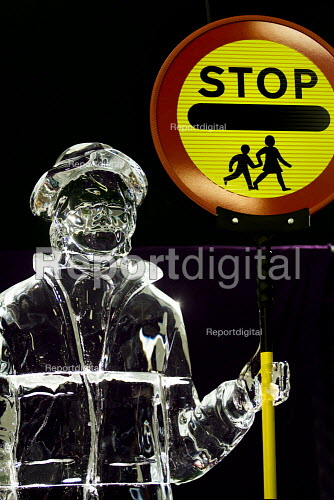 UNISON unveils a 2.5 meter ice sculpture of a school lollipop lady, to promote the union Million Voices campaign message. �The ice sculpture appearance/disappearance at the labour party conference, sends a message to the Government that it should keep up investment in the public sector, or essential public services that people rely on will vanish. Labour Party Conference 2009. Brighton. - Jess Hurd - 2009-09-29