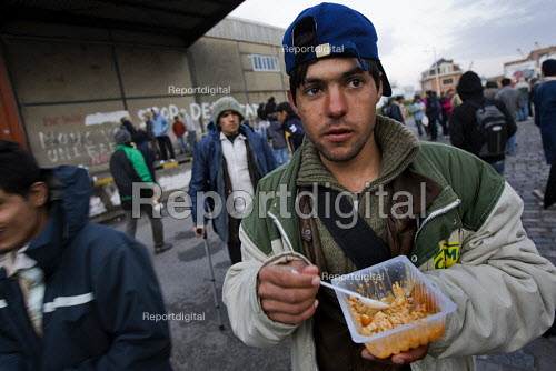 Refugees in Calais made homeless after the clearing of the Jungle queue for food from the Salam charity. France. - Jess Hurd - 2009-10-16
