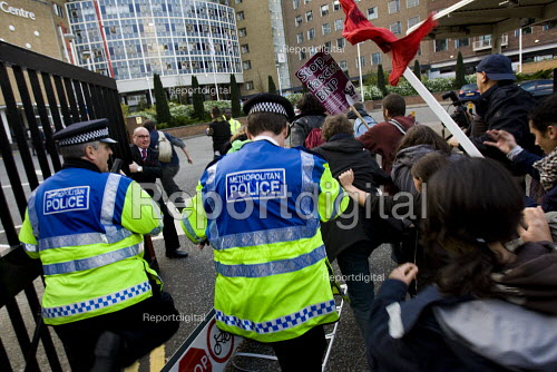 Unite Against Fascism protestors break through the gate into BBC Television Centre. Demonstration opposing the invitation of BNP leader Nick Griffin on Question Time. White City. - Jess Hurd - 2009-10-22