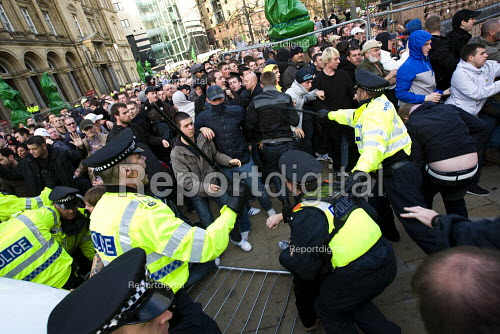 Police baton EDL supporters as they surge through the police cordon to rampage through the streets. English Defence League march in Leeds - Jess Hurd - 2009-10-31