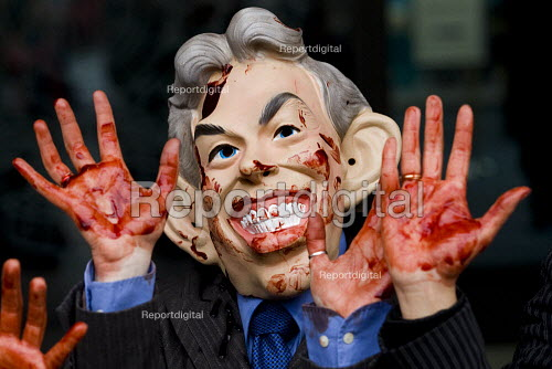 Stop the War protest representing Tony Blair, George W Bush and Gordon Brown with blood on their hands at the first public hearing of the Iraq Inquiry. Queen Elizabeth Conference Centre, London. - Jess Hurd - 2009-11-24