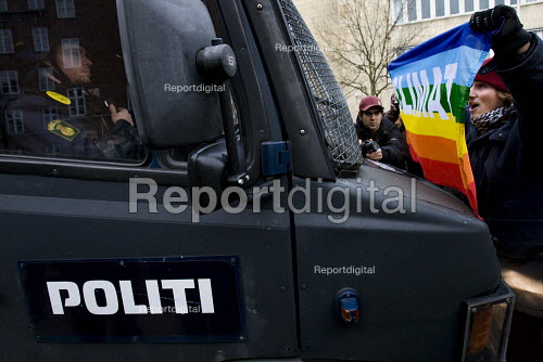 Protester stops a riot van with a Climate flag. COP15 United Nations Climate Change Conference, Copenhagen 2009, Denmark. - Jess Hurd - 2009-12-11