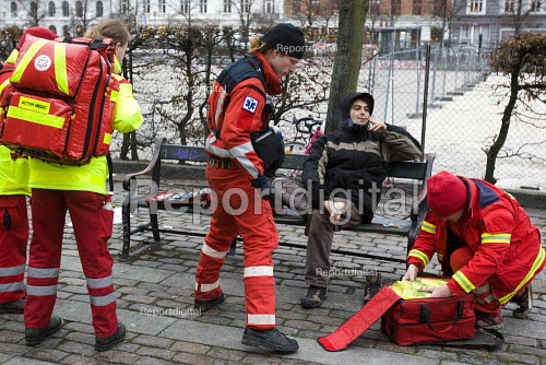 Demonstrator is treated by paramedics for a foot blister. No Borders protest, defending refugees. COP15 United Nations Climate Change Conference, Copenhagen 2009, Denmark. - Jess Hurd - 2009-12-14
