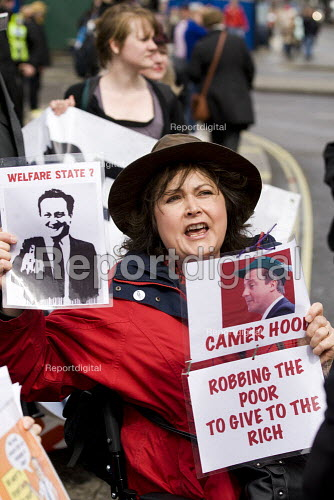 David Cameron as Camer Hood: robbing the poor to give to the rich. Disabled activists demonstrate and block Trafalgar Square against benefit cuts and the Welfare Reform Bill. London. - Jess Hurd - 2012-04-18