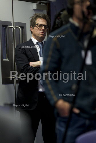 Actor Hugh Grant at the back of a Hacked Off press conference in response to the final report of the Leveson Enquiry into media ethics is delivered by Lord Leveson. QEII Centre, London. - Jess Hurd - 2012-11-29