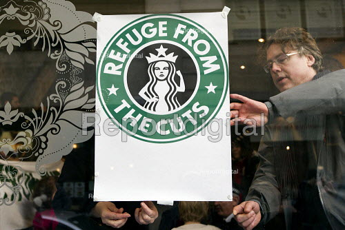 Tax avoidance campaigners, UK Uncut occupy a Starbucks cafe off Regents Street. Organisers highlight the government cuts to women and transform Starbucks stores across the country into refuges, creches and homeless shelters. London. - Jess Hurd - 2012-12-08
