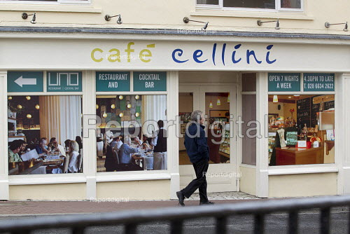 Fake shop front with window posters representing a non existant cafe  cellini. G8 Summit.