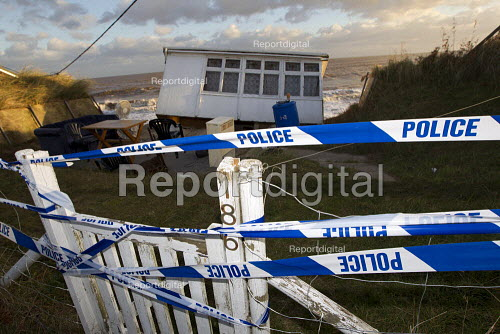 Police tape. Badly damaged cliff-top homes after Xavier, the largest tidal surge in 60 years battered the east coast of England. - Jess Hurd - 2013-12-06