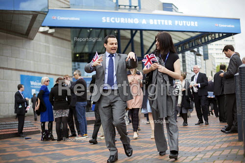 Delegates leave Conservative Party Conference with small Union Jack flags. The ICC Birmingham - Jess Hurd - 2014-10-01