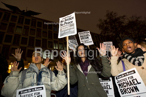 Hands up don't shoot! Solidarity with Ferguson - Justice for Michael Brown. Protest began at the US Embassy and ended at Scotland Yard. London - Jess Hurd - 2014-11-26