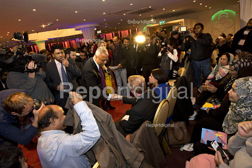 Lutfur Rahman greets Times newspaper investigative journalist Dominic Kennedy as hundreds of supporters gather to defend the Tower Hamlets Mayor against financial allegations and smears from Eric Pickles MP and the media. East London. - Jess Hurd - 2014-11-13